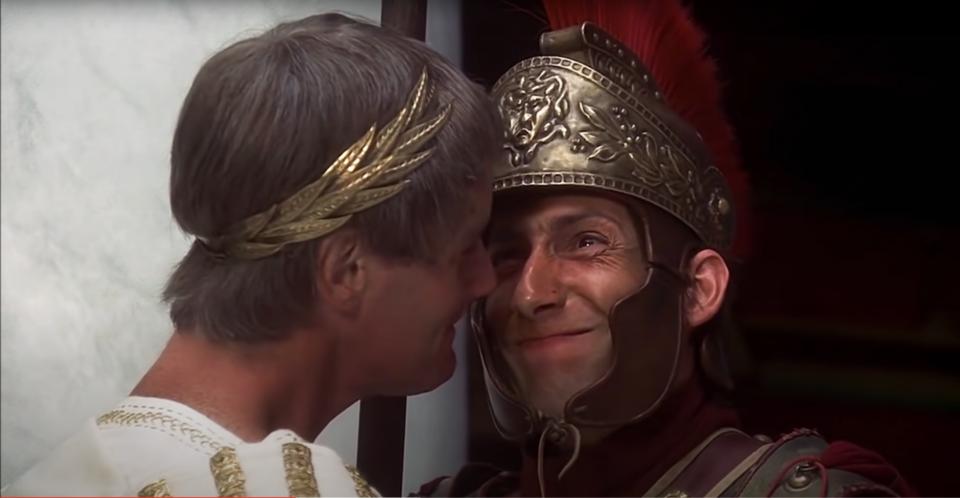 Roman Soldier holding back laugh as Roman Consul say the name of his good friend Biggus Dickus.